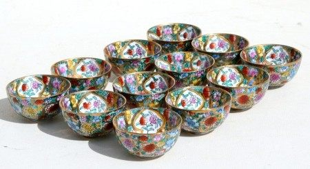 A set of twelve Chinese millefiori wine cups each depicting signs of the Chinese zodiac, 5cms (2ins)