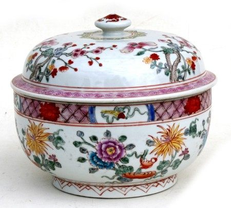A Chinese famille rose bowl & cover decorated with flowers, six character red mark to underside,