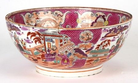 A 19th century porcelain bowl with chinoiserie decoration, 27cms (10.5ins) diameter (a/f).