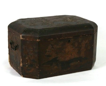 A 19th century Japanese lacquer box decorated in relief with landscape scenes, 46cms (17ins) wide.
