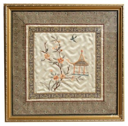 A Chinese silk embroidered panel depicting flowers and a bird, framed & glazed, 21 by 21cms (8.25 by