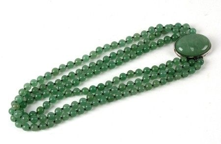 A Chinese Bowenite three-strand bead necklace, 46cms (18ins) long.