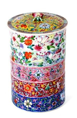 A Chinese famille rose five-tier stacking bowls and cover of cylindrical form, with peach finial and