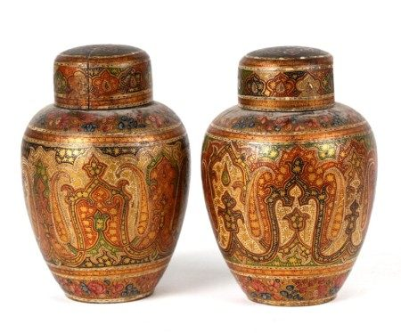 A pair of Persian / Indian lacquered vases and covers decorated with stylised flowers, 10cms (