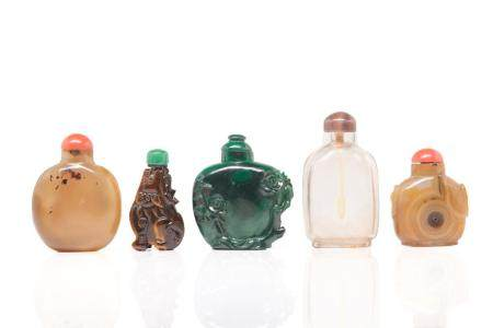 FIVE CARVED MIXED HARDSTONE CHINESE SNUFF BOTTLES