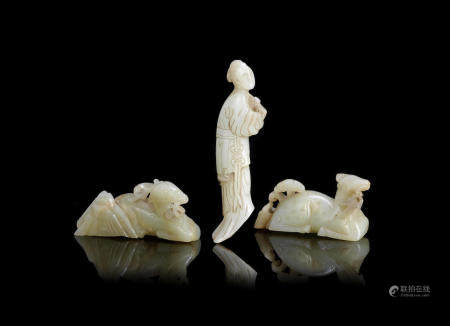 A group of three pale green jade carvings Ming Dynasty (3)
