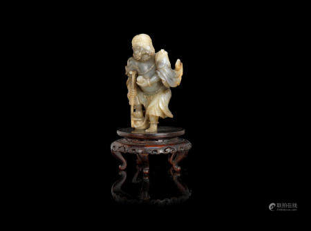 A pale green and grey jade carving of Li Tieguai 18th/19th century