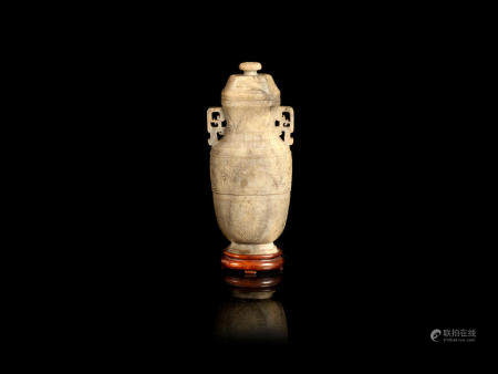 A calcified jade archaistic vase and cover  Mid-Qing Dynasty  (2)