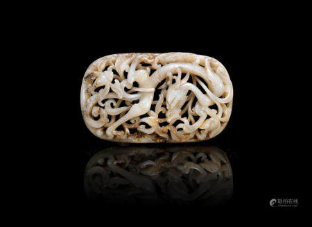 A mottled black and white jade reticulated 'dragon' plaque Ming Dynasty