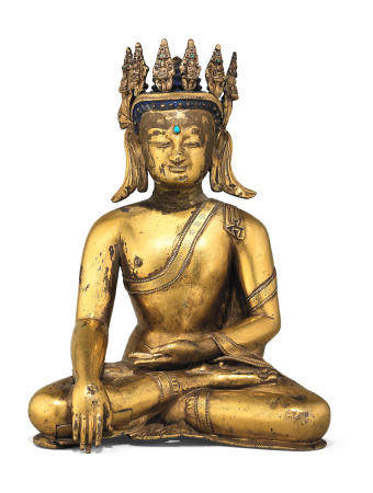 A rare gilt copper-alloy figure of crowned Buddha Tibet, 15th century