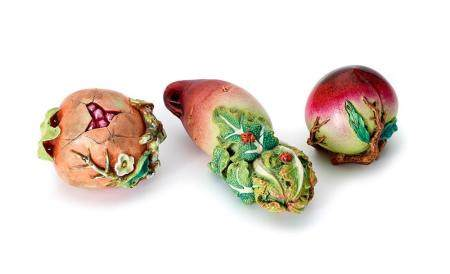 A GROUP OF THREE ENAMELLED MODELS OF FRUIT AND A VEGETABLE,