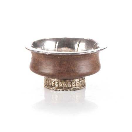 A TIBETAN YAK BUTTER CUP Circular, the wooden cup with a silver lining, on a silver-mounted circular