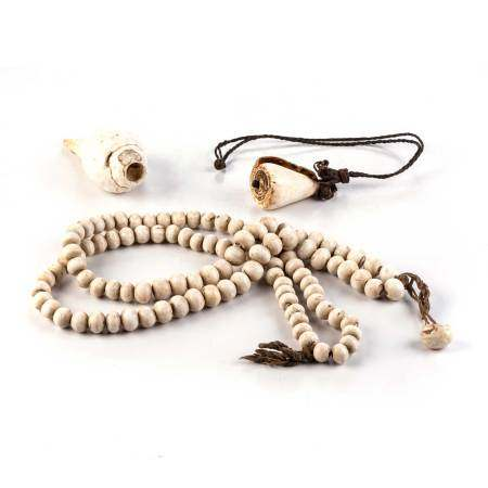 A TIBETAN CONCH BEAD MALA, 19TH CENTURY NOT SUITABLE FOR EXPORTComposed of one hundred and eight