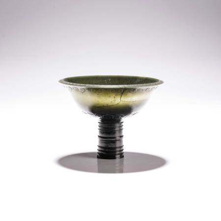 A CHINESE SPINACH JADE 'RUYI AND LOTUS' STEM-CUP, QING DYNASTY, 19TH CENTURY The wide flaring bowl