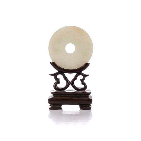 A CHINESE CELADON JADE 'BI' DISC, REPUBLIC PERIOD, 1912 - 1949 The circular disc with a conforming