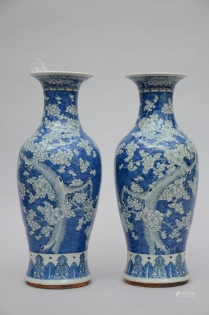 A pair of Chinese vases in blue and white porcelain 'prunus blossoms' (*) (59cm)
