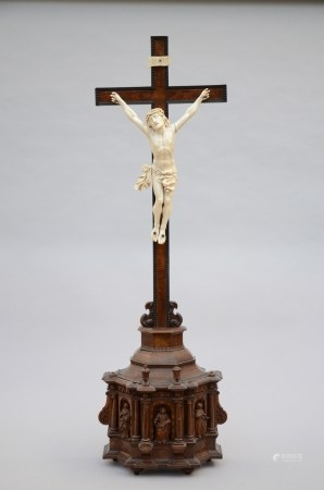 A large ivory corpus on a walnut base (120cm)