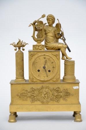 An Empire clock in gilt bronze 'amor' (11x26x40cm)