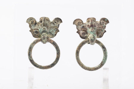 A pair of Chinese Archaic ornaments in bronze 'Taotie masks' (7x11cm)