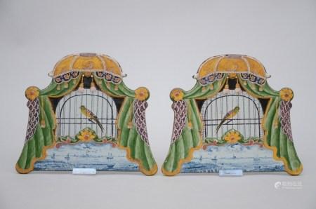 A pair of polychrome Dutch plaques 'bird cage' (25x21cm)