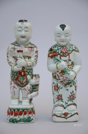A pair of hÈhÈ statues in Chinese porcelain, Kangxi period (*) (33cm)