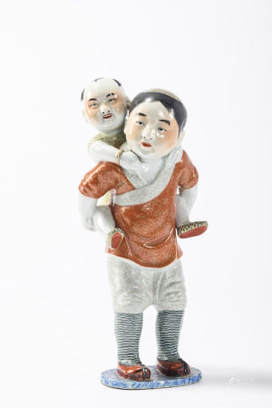 A sculpture in Chinese porcelain 'boys' (*) (43cm)