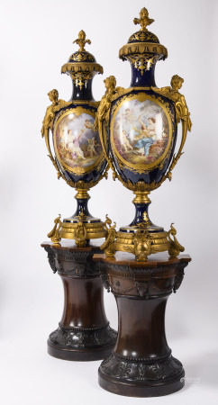 A pair of monumental vases in SËvres porcelain with gilt bronze mounts on mahogany stands, 19th