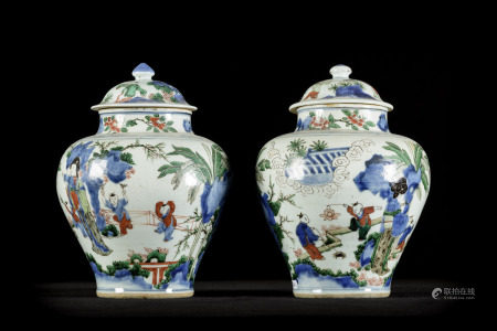 A pair of Chinese Wucai vases 'children playing', 17th century (*) (34cm)