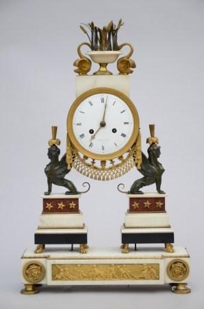 A Louis XVI marble and bronze clock, signed Honin ‡ LiËge (11x36x57cm)