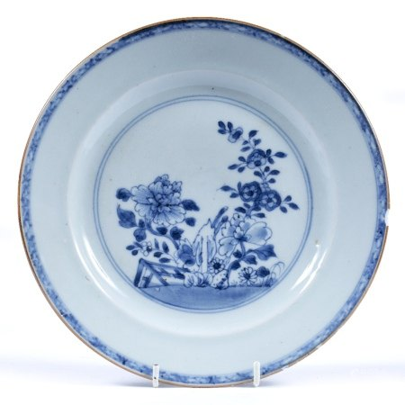 Blue and white dish Chinese, 18th Century decorated to the centre depicting flowers in a garden 23cm