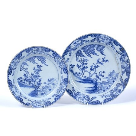 Two blue and white plates Chinese 19th Century the first decorated depicting a river with two