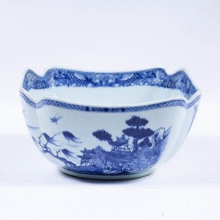 Blue and white export bowl Chinese, 19th Century decorated to the sides depicting pavilions and