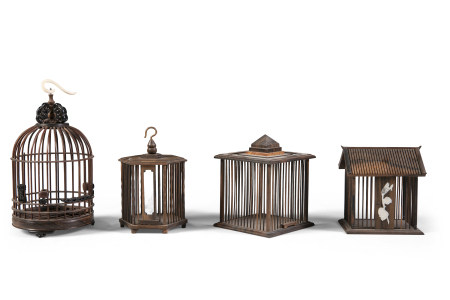 A COLLECTION OF FOUR HARDWOOD CRICKET CAGES. The largest 19cm high