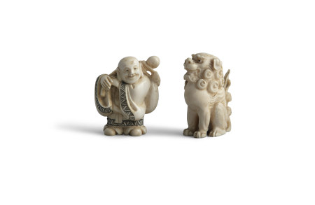 A FINELY CARVED JAPANESE OKIMONO, 19th century, modelled as a seated shishi, with curled mane and