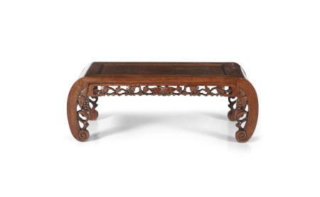 A CHINESE CARVED WOOD KANG TABLE, 20th century, of rectangular form with incurved legs and pierced