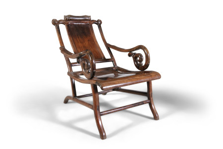 A CHINESE HARDWOOD RECLINING OPIUM CHAIR, Qing Dynasty, with scrollwork neck rest, solid panel