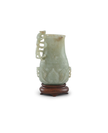 A PALE CELADON JADE VESSEL, 18th century, of flattened baluster form, with chilong side handle,