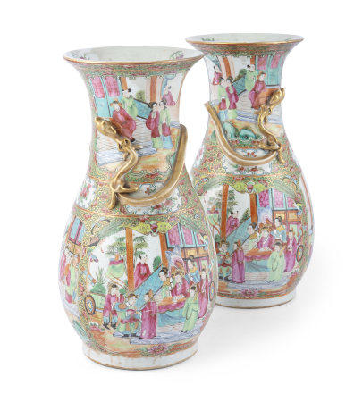A PAIR OF CHINESE FAMILLE ROSE CANTON VASES, mid-19th century, with pear shaped bodies and flared