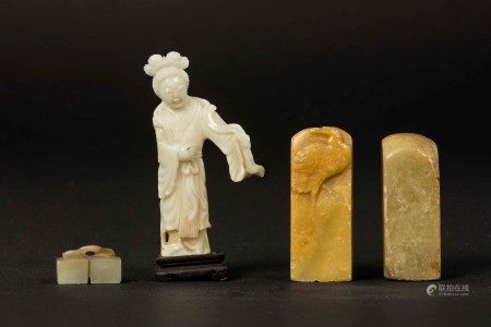 A lot made up by two soapstone seals, a small Guanyin in white coral and a buckle in white jade and russet, China, Qing Dynasty, 19th-20th century