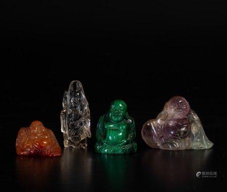 Lotto composto da piccole sculture in materiali diversi in pietra dura tre raffiguranti Budai e una saggio, Cina, XX secolo