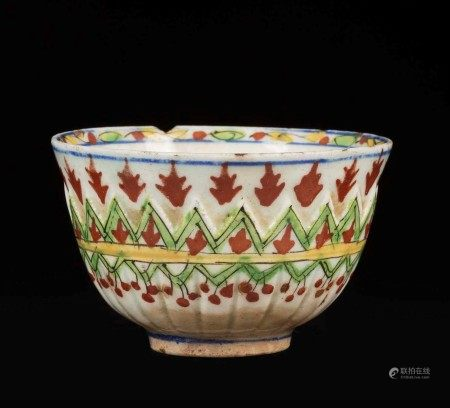 A small porcelain bowl with an embossed and polychrome stylised vegetal decor, Turkey, 18th century