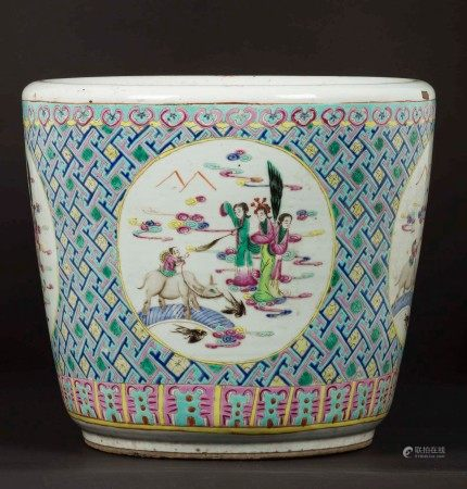 A polychrome glazed porcelain cachepot with Guanyin within reserves, China, Qing Dynasty, 19th century