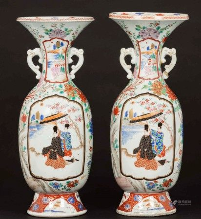 A pair of polychrome enamel vases with a figure of a dignitary, Japan, late 19th-early 20th century