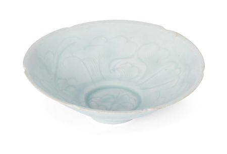 A Chinese qingbai porcelain lobed bowl, Song dynasty, carved to the interior with a continuous