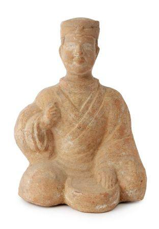 A Chinese teracotta figure of a musician, Han dynasty, modelled seated with a drum between his