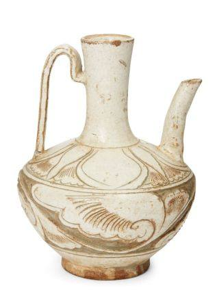 A Chinese grey stoneware Cizhou ewer, Song/Yuan dynasty, deeply incised beneath the transparent pale