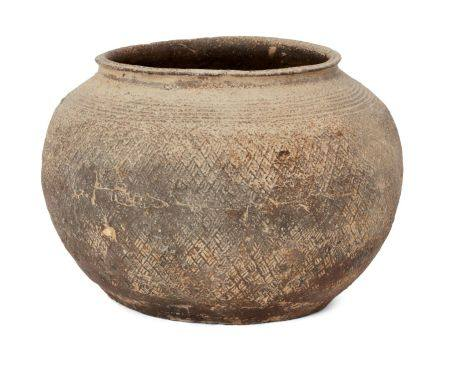 A Chinese grey pottery jar, Warring States period, with broad mouth and slightly everted rim,