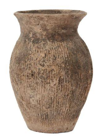 A Chinese grey pottery vase, Warring States, incised with vertical lines to body, 17.5cm high 戰國