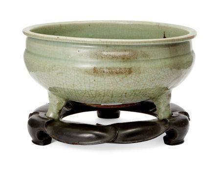 A large Chinese grey stoneware Longquan celadon tripod censer, Ming dynasty, carved to the
