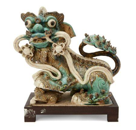 A large Chinese pottery figure of a Buddhist lion, late Ming dynasty, modelled seated, with back